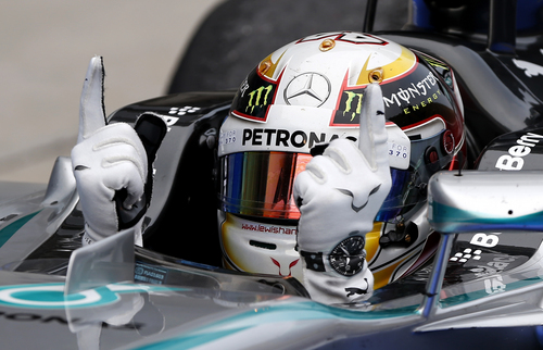 Mercedes driver Lewis Hamilton of Britain gestures in his car after winning the Malaysian Formula One Grand Prix at Sepang International Circuit in Sepang, Malaysia, Sunday, March 30, 2014. (AP Photo/Vincent Thian)