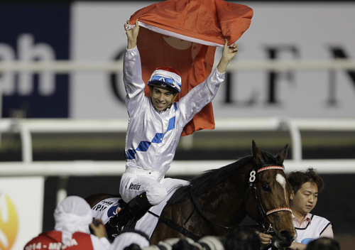 Joao Moreira on Amber Sky from Australia celebrates after he wins the Al Quoz Sprint horse race on the Dubai World Cup day at Meydan Racecourse in Dubai, United Arab Emirates, Saturday, March 29, 2014. (AP Photo/Kamran Jebreili)