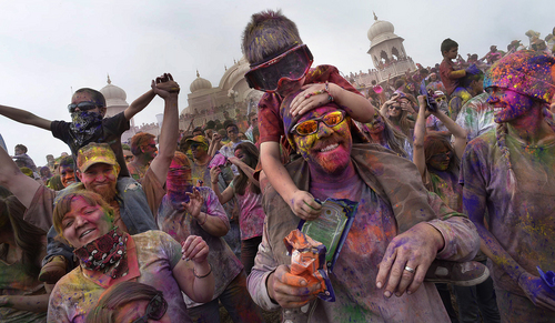 Scott Sommerdorf      The Salt Lake Tribune The Ellis, Zonts, and Ottersen families of Springville and Tanner just prior to the second throw of colors of the day as they celebrate the Holi festival of colors at the Sri Radha Krishna Temple in Spanish Fork, Saturday, March 29, 2014. Revelers celebrate the arrival of spring on the grounds of the temple.
