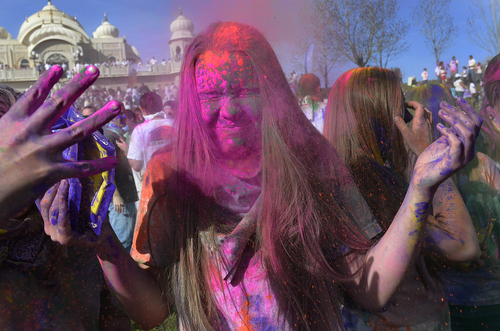 Scott Sommerdorf   |  The Salt Lake Tribune Ana Winters cringes as she is hit in the face with some colors at the Holi festival of colors at the Sri Radha Krishna Temple in Spanish Fork, Saturday, March 29, 2014. Revelers celebrate the arrival of spring on the grounds of the temple.