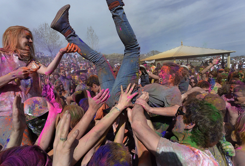 "Scott Sommerdorf   |  The Salt Lake Tribune Participants ""crowd surf"" at the Holi festival of colors at the Sri Radha Krishna Temple in Spanish Fork, Saturday, March 29, 2014. Revelers celebrate the arrival of spring on the grounds of the temple."
