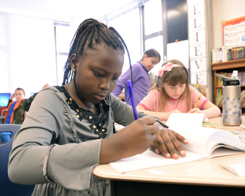 Al Hartmann  |  Tribune file photo Bennion Elementary School fourth grader Kelly Tumusifu works through a spelling excercise in December 2013. A new Kids Count study, Race for Results, points up disparities in the well-being of children from different racial and ethnic groups.
