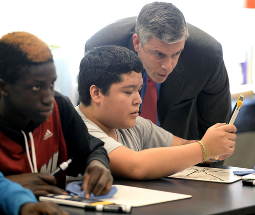 Al Hartmann  |  Tribune file photo Francisco Gomez shows U.S. Education Secretary Arne Duncan how to work through a problem with an Npire calculator at Northwest Middle School in Salt Lake City in December 2013. Northwest, where 87 percent of students are members of ethnic minorities, is one of many diverse schools in the state. A new Kids Count study, Race for Results, points up disparities in the well-being of children from different racial and ethnic groups.