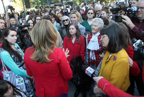 Rick Egan  | The Salt Lake Tribune   Ruth Todd, LDS spokesperson, talks to the group Ordain Women, speaks to the group onTemple Square as they attempted to stand in the standby line to try to gain admittance to the Priesthood session of the 183rd Semi-annual General Conference, Saturday, October 5, 2013.