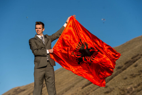 Trent Nelson  |  The Salt Lake Tribune Taggart Befus is heading to Albania on an LDS mission. He posed with the Albanian flag in Draper.