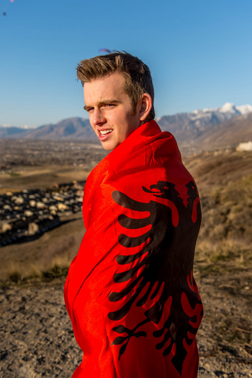 Trent Nelson  |  The Salt Lake Tribune Taggart Befus is heading to Albania on an LDS mission. He posed with the Albanian flag in Draper, Saturday, March 22, 2014.