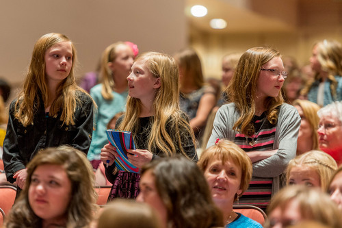 Trent Nelson     The Salt Lake Tribune Young girls stand during a talk by Primary General President Rosemary Wixom, at the LDS General Women's Meeting at the Conference Center in Salt Lake City, Saturday March 29, 2014. For the first time ever for Young Women and Relief Society and Primary will meet altogether, with every LDS female 8 and up invited.