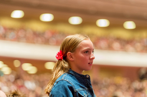 Trent Nelson     The Salt Lake Tribune A young girl stands during a talk by Primary General President Rosemary Wixom, at the LDS General Women's Meeting at the Conference Center in Salt Lake City, Saturday March 29, 2014. For the first time ever for Young Women and Relief Society and Primary will meet altogether, with every LDS female 8 and up invited.