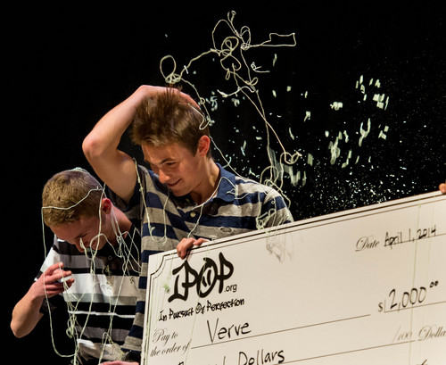 Trent Nelson  |  The Salt Lake Tribune Alta High School students Matt Blake and Zach Gundry are covered in silly string after taking first place at the IPOP Foundation's second annual Mobile App Idea Competition with their mobile app Verve, in Sandy, Tuesday April 1, 2014.
