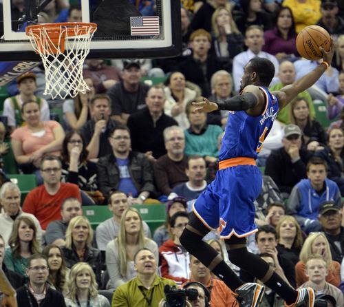 Rick Egan  |  The Salt Lake Tribune  New York Knicks guard Tim Hardaway Jr. (5) goes up for a flying slam-dunk, in NBA action, Utah Jazz vs. the New York Knicks, at EnergySolutions arena, Monday, March 31, 2014