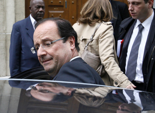 FILE  - President-elect Francois Hollande leaves the Socialist Party headquarters in Paris Tuesday May 8, 2012.  Hollande is set to embark on a frenetic series of international political meetings, which have been scheduled following his Presidential election victory. (AP Photo/Michel Spingler)