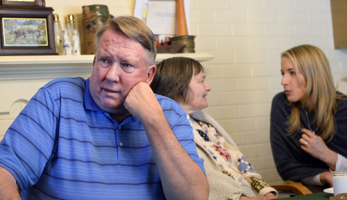 Al Hartmann  |  The Salt Lake Tribune Merrill Cook, former congressman and perennial candidate, is now a full-time caregiver for his wife, Camille, who suffers from Alzheimer's disease.  Their daughter Alison talks to her mother, Camille.