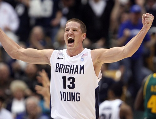 Steve Griffin  |  Tribune file photo  BYU's Brock Zystra holds his fists in the air and screams with excitement as BYU pulls ahead of Baylor during frist half action of the BYU Baylor basketball game  in Provo, Utah Saturday, December 17, 2011.