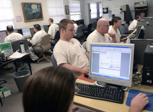 Al Hartmann  |  The Salt Lake Tribune  Inmates do genealogy research on computers in the Family History Center in the Wasatch unit at the Utah State Prison in Draper.