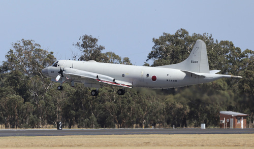 A Japan Maritime Self-Defense Force P-3 Orion takes off at RAAF Base Peace in Perth, Australia, Wednesday, April 2, 2014. Ten planes and nine ships resume the search for the missing Malaysia Airlines flight MH370 in the southern Indian Ocean. (AP Photo/Rob Griffith)