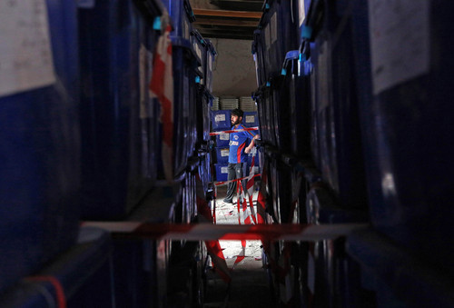 Ballot boxes are seen piled up at an election commission office in Jalalabad east of Kabul, Afghanistan, Wednesday, April 2, 2014. Eight Afghan presidential candidates are campaigning for the third presidential election. Elections will take place on April 5, 2014. (AP Photo/Rahmat Gul)