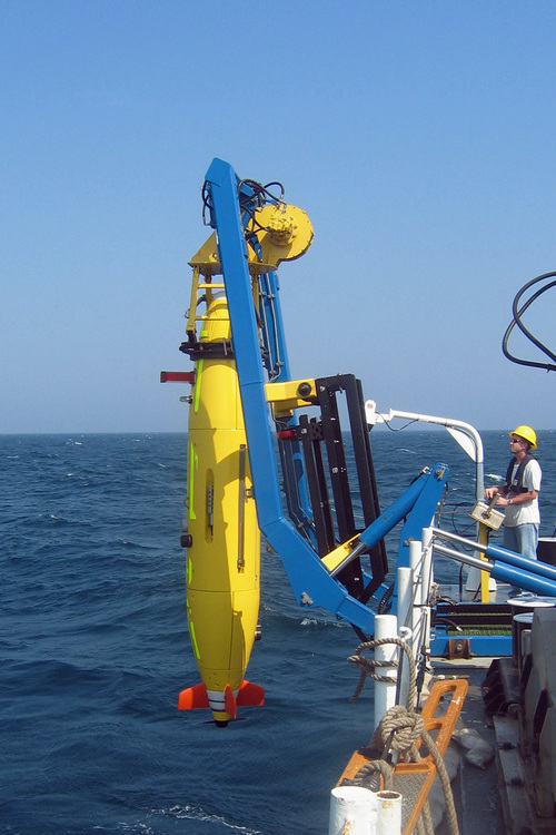 This undated photo provided on April 1, 2014 by Hydroid via the Woods Hole Oceanograhic Institute shows the REMUS 6000 unmanned sub being launched. Unmanned subs, also called autonomous underwater vehicles or AUVs, played a critical role in locating the wreckage of a lost Air France jet in 2011, two years after it crashed in the middle of the south Atlantic. The find allowed searchers to recover the black boxes that revealed the malfunctions behind the tragedy. (AP Photo/Hydroid)