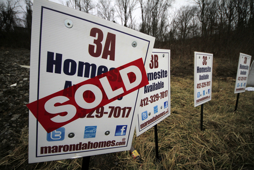 FILE - In this Monday, Jan. 13, 2014, file photo, a  sold sign is placed on a homesite in the Grace Manor townhouse development in Robinson Township, Pa. Freddie Mac, the mortgage company, releases weekly mortgage rates, on Thursday, April 3, 2014. (AP Photo/Gene J. Puskar, File)