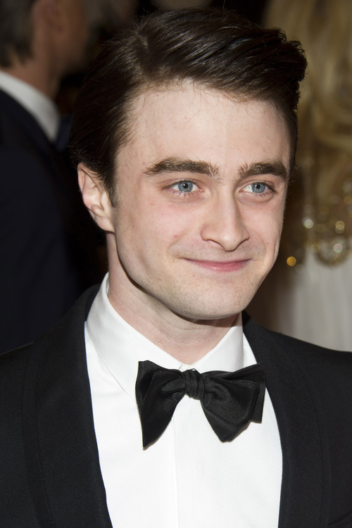 """FILE - In this May 7, 2012 file photo, Daniel Radcliffe arrives at the Metropolitan Museum of Art Costume Institute gala benefit, celebrating Elsa Schiaparelli and Miuccia Prada, in New York. The """"Harry Potter"""" star Radcliffe has landed his first entry in the Sundance Film Festival. He plays poet Allen Ginsberg in the drama """"Kill Your Darlings,"""" which premieres next January at Robert Redford's Sundance festival. (AP Photo/Charles Sykes, File)"""