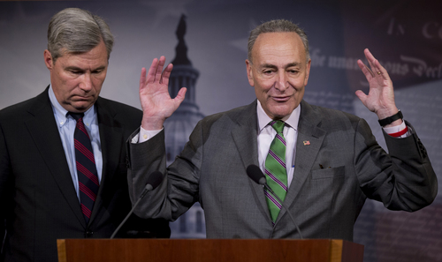 Sen. Charles Schumer, D-N.Y., right, accompanied by Sen. Sheldon Whitehouse, D-R.I., speak to reporters on Capitol Hill in Washington, Wednesday, April 2, 2014, about the Supreme Court1s decision in the McCutcheon vs. FEC case, in which the Court struck down limits in federal law on the aggregate campaign contributions individual donors may make to candidates, political parties, and political action committees.  (AP Photo/Manuel Balce Ceneta)
