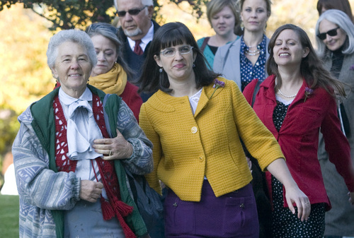 Rick Egan  | The Salt Lake Tribune   Nadine Hansen (left) and Katie Kelly (yellow)  lead the group Ordain Women as they walk to LDS Conference Center to stand in the standby line to try to gain admittance to the Priesthood session of the 183rd Semi-annual General Conference, Saturday, October 5, 2013.
