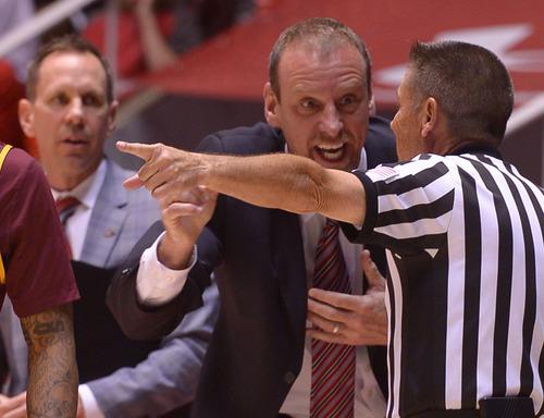Leah Hogsten  |  The Salt Lake Tribune Utah Utes head coach Larry Krystkowiak debates a call with the referee. University of Utah defeated Arizona State 86-63 Sunday, February 23, 2014, at the Jon M. Huntsman Center.