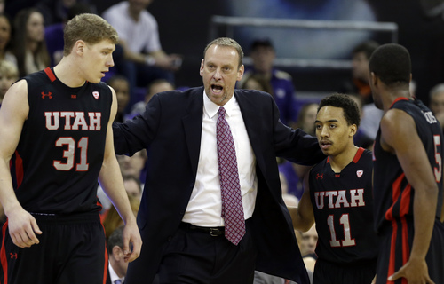 Utah head coach Larry Krystkowiak talks with Dallin Bachynski (31), Brandon Taylor (11) and Jarred DuBois (5) during a brief break in the first half of an NCAA college basketball game Saturday, Jan. 19, 2013, in Seattle. Utah won 74-65. (AP Photo/Elaine Thompson)