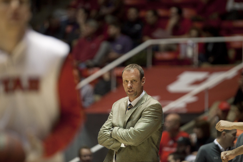 JIM MCAULEY   The Salt Lake Tribune Utah head coach Larry Krystkowiak looks on as Utah plays against the St. Katherine Firebirds at the University of Utah's Huntsman Center on December 28, 2013.