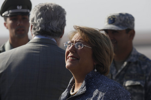 Chile's President Michelle Bachelet arrives to the airport in Arica, Chile one day after an earthquake on the Pacific coast, Wednesday, April 2, 2014. Hard-won expertise and a big dose of luck helped Chile escape its latest magnitude-8.2 earthquake with surprisingly little damage and death for such a powerful shift in the undersea fault that runs along the length of South America's Pacific coast. (AP Photo/Luis Hidalgo, Pool)