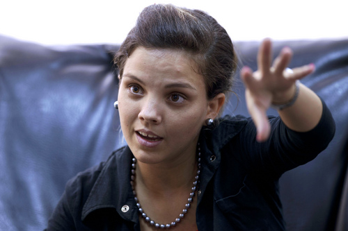 """In this Feb. 28, 2014 photo, Saimi Reyes speaks during an interview with Associated Press in Havana, Cuba. The Obama administration secretly financed a social network in Cuba to stir political unrest and undermine the country's communist government. An Associated Press investigation found the program, The project, dubbed """"ZunZuneo,"""" slang for a Cuban hummingbird's tweet, evaded Cuba's Internet restrictions by creating a text-messaging service that could be used to organize political demonstrations. It drew in tens of thousands of subscribers who were unaware it was backed by the U.S. government. Carmona was a journalism student at the University of Havana when she stumbled onto ZunZuneo. She was intrigued by the service's novelty, and the price. The advertisement said """"free messages"""" so she signed up using her nickname, Saimita. (AP Photo/Franklin Reyes)"""