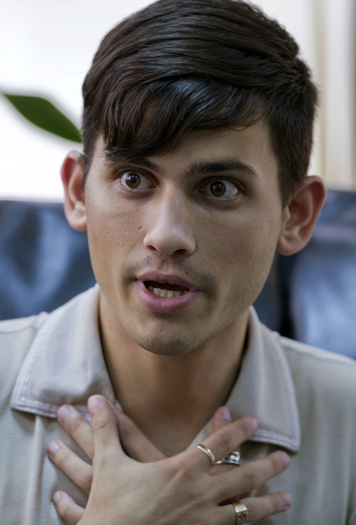 """In this Feb 28, 2014 photo, Ernesto Guerra speaks during an interview with Associated Press in Havana, Cuba. The Obama administration secretly financed a social network in Cuba to stir political unrest and undermine the country's communist government. An Associated Press investigation found the program, The project, dubbed """"ZunZuneo,"""" slang for a Cuban hummingbird's tweet, evaded Cuba's Internet restrictions by creating a text-messaging service that could be used to organize political demonstrations. It drew in tens of thousands of subscribers who were unaware it was backed by the U.S. government. """"How was I supposed to realize that?"""" Guerra asked. """"It's not like there was a sign saying 'Welcome to ZunZuneo, brought to you by USAID.'""""  (AP Photo/Franklin Reyes)"""