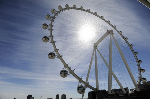 The Las Vegas High Roller at The LINQ begins to operate on Monday, March 31, 2014, in Las Vegas. The 550-foot-tall attraction, which opened to the public on Monday, is the highest observation wheel in the world and features 28 cabins that can accommodate up to 40 people each. (AP Photo/David Becker)