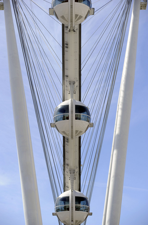 The Las Vegas High Roller at The LINQ is seen on March 31, 2014, in Las Vegas. The 550-foot-tall attraction, which opened to the public today, is the highest observation wheel in the world and features 28 cabins that can accommodate up to 40 people each. (AP Photo/David Becker)