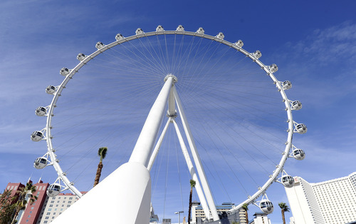 The Las Vegas High Roller at The LINQ is seen on Monday, March 31, 2014, in Las Vegas. The 550-foot-tall attraction, which opened to the public today, is the highest observation wheel in the world and features 28 cabins that can accommodate up to 40 people each. (AP Photo/David Becker)