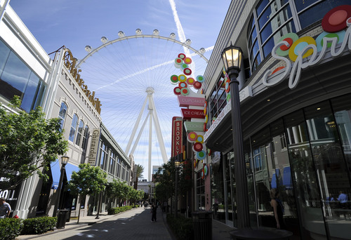 The Las Vegas High Roller towers over the shops at The LINQ on Monday, March 31, 2014, in Las Vegas.  The 550-foot-tall attraction, which opened to the public Monday, is the highest observation wheel in the world.  A full revolution takes 30 minutes.   The height tops the nearly 443-foot London Eye and the 541-foot Singapore Flyer. (AP Photo/David Becker)