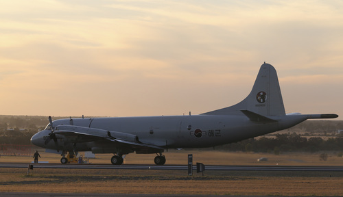 A South Korean Navy P-3 Orion sits on the runway after returning from a search operation for the missing Malaysia Airlines Flight MH370, at Royal Australian Air Force base Peace in Perth, Australia, Thursday, April 3, 2014. The search operation continues but no trace of the Boeing 777 has been found nearly a month after it vanished in the early hours of March 8 on a flight from Kuala Lumpur to Beijing with 239 people on board. (AP Photo/Rob Griffith, Pool)