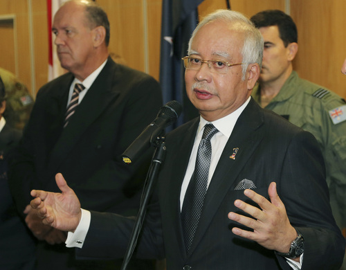"""Malaysian Prime Minister Najib Razak speaks at a breakfast with crew members from different countries involved in the search for wreckage and debris of the missing Malaysia Airlines MH370 in Perth, Australia, Thursday, April 3, 2014. In a hastily called speech, Malaysian Prime Minister Najib Razak announced that an unprecedented analysis of satellite signals concluded that Malaysia Airlines Flight 370 """"ended"""" deep in the Indian Ocean, far from any possible refuge for the 239 souls aboard. (AP Photo/Rob Griffith, Pool)"""