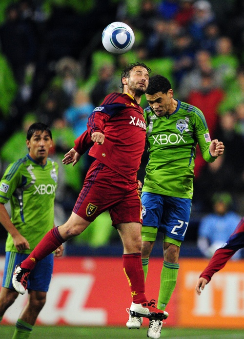 Real Salt Lake's Ned Grabavoy, left, fights for the ball against Sounders FC's Lamar Neagle in the second half during an MLS Cup Playoff match at CenturyLink Field on Wednesday, Nov. 2, 2011, in Seattle. Real Salt Lake defeated Seattle and advances to the next round.  (John Lok / The Seattle Times)