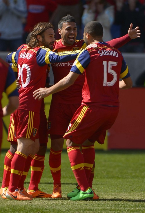 Leah Hogsten  |  The Salt Lake Tribune Real Salt Lake midfielder Ned Grabavoy (20) and Real Salt Lake midfielder Javier Morales (11) celebrate Real Salt Lake forward Alvaro Saborio's  (15) first half goal. Real Salt Lake and the L.A. Galaxy are 1-1 at the half during Saturdayís, March 22, 2014 home opener at Rio Tinto Stadium.