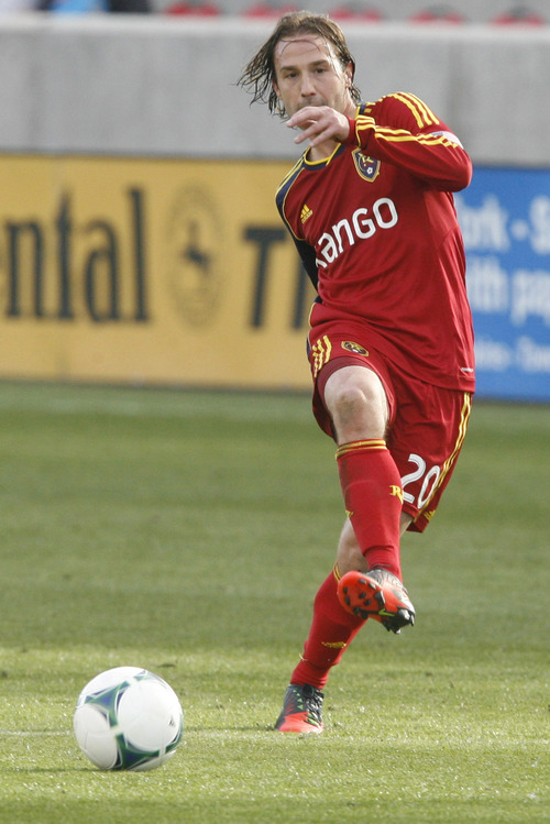 Rick Egan  | The Salt Lake Tribune   Ned Grabavoy (20) kicks the ball for Real Salt Lake in MLS soccer action, at RIo Tinto Stadium, Saturday, March 16, 2013.