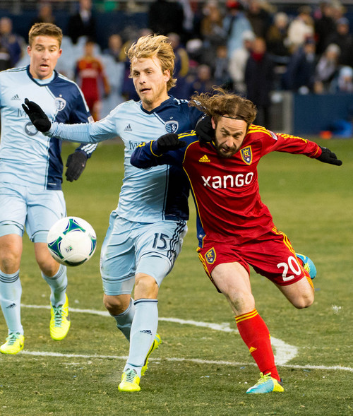 Trent Nelson  |  The Salt Lake Tribune Real Salt Lake's Ned Grabavoy (20) defended by Sporting KC's Seth Sinovic (15) as Real Salt Lake faces Sporting KC in the MLS Cup Final at Sporting Park in Kansas City, Saturday December 7, 2013.