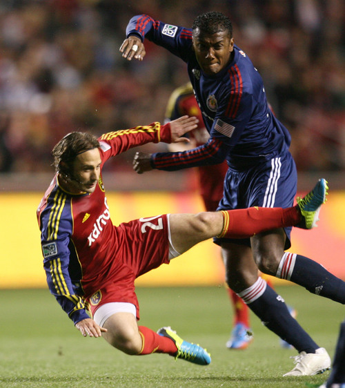 Steve Griffin  |  The Salt Lake Tribune   RSL midfielder Ned Grabavoy gets knocked to the ground by Chivas USA midfielder Oswaldo Minda during first half action in the Real Salt Lake versus Chivas USA soccer match at Rio TInto Stadium in Sandy, Utah Wednesday, October 23, 2013.