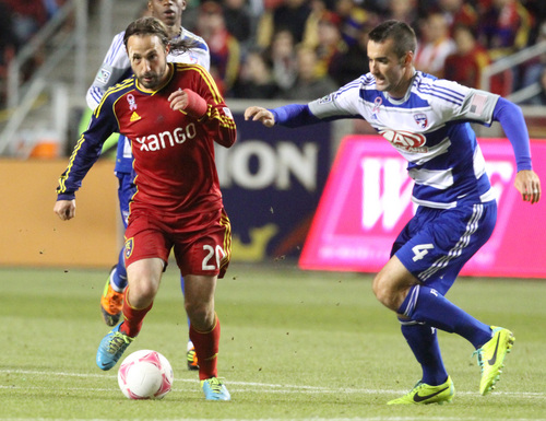 Rick Egan  | The Salt Lake Tribune   Real Salt Lake midfielder Ned Grabavoy (20) outruns FC Dallas midfielder Andrew Jacobson (4), in MLS soccer action at Rio Tinto Stadium, Saturday, October 5, 2013.