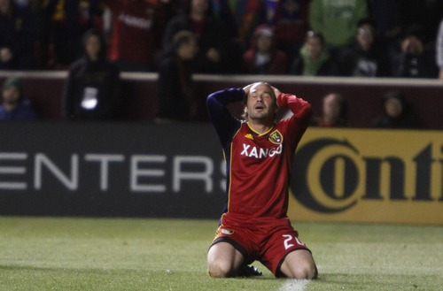 Rick Egan  | The Salt Lake Tribune   Real Salt Lake's Ned Grabavoy (20) reacts after narrowly missing a goal,  in MLS action, Real Salt Lake vs. New England Revolution, at Rio Tinto Stadium, Saturday, May 5, 2012.