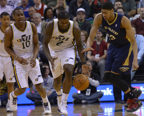 Leah Hogsten  |  The Salt Lake Tribune Utah Jazz forward Marvin Williams (2) makes the steal on New Orleans Pelicans forward Anthony Davis (23). The Utah Jazz defeated the New Orleans Pelicans 100-96 during their game Friday, April 4, 2014 at Energy Solutions Arena.