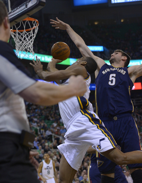 Leah Hogsten  |  The Salt Lake Tribune Utah Jazz guard Alec Burks (10) draws the foul on New Orleans Pelicans center Jeff Withey (5). The Utah Jazz defeated the New Orleans Pelicans 100-96 during their game Friday, April 4, 2014 at Energy Solutions Arena.