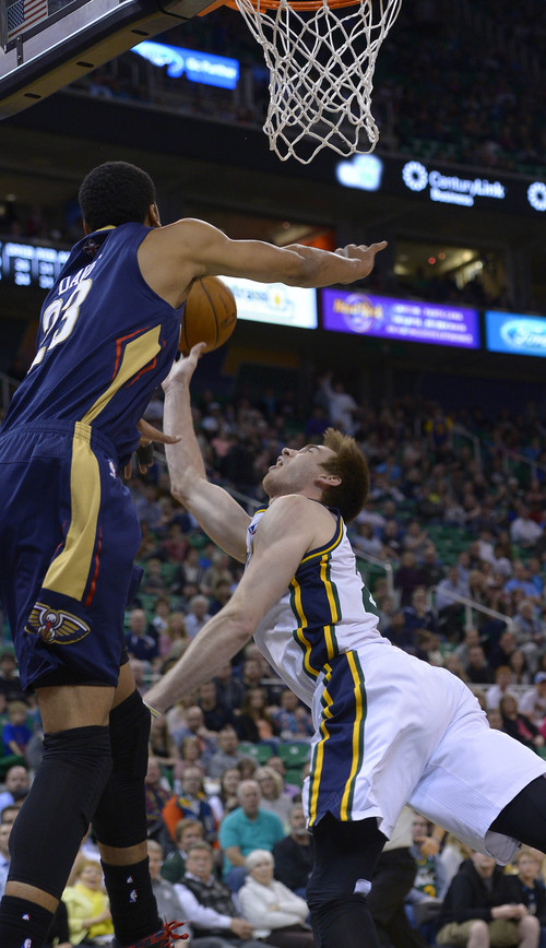 Leah Hogsten  |  The Salt Lake Tribune Utah Jazz guard Gordon Hayward (20) is fouled by New Orleans Pelicans forward Anthony Davis (23). The Utah Jazz defeated the New Orleans Pelicans 100-96 during their game Friday, April 4, 2014 at Energy Solutions Arena.