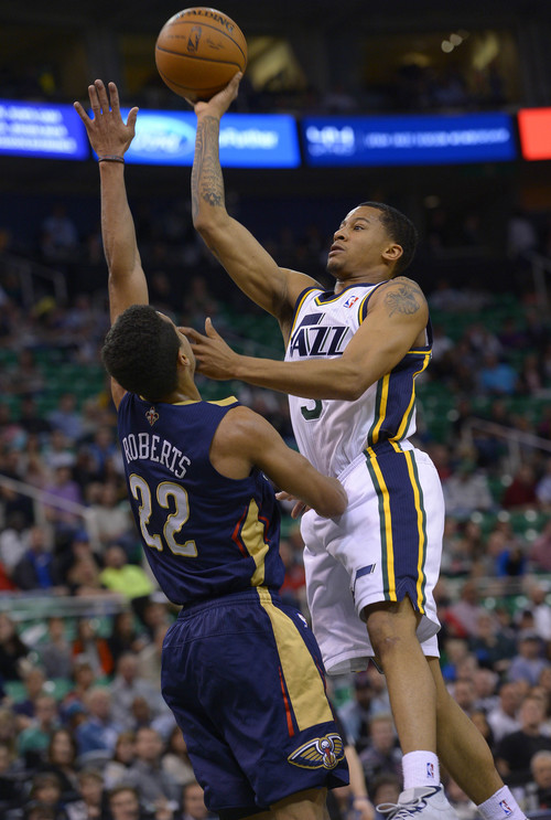 Leah Hogsten  |  The Salt Lake Tribune Utah Jazz guard Trey Burke (3) fires one over the hands of New Orleans Pelicans guard Brian Roberts (22) during the first half of their game Friday, April 4, 2014 at Energy Solutions Arena.
