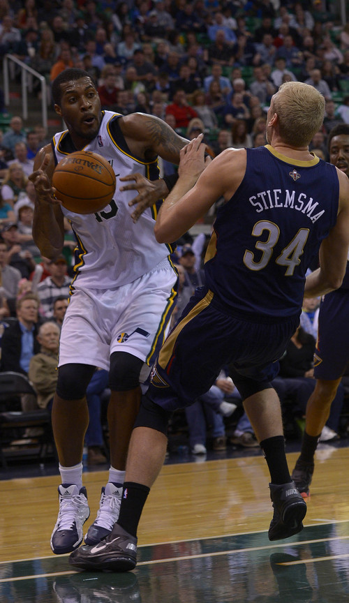 Leah Hogsten  |  The Salt Lake Tribune Utah Jazz center Derrick Favors (15) steps on the foot of New Orleans Pelicans center Greg Stiemsma (34) and draws an offensive foul. The Utah Jazz defeated the New Orleans Pelicans 100-96 during their game Friday, April 4, 2014 at Energy Solutions Arena.
