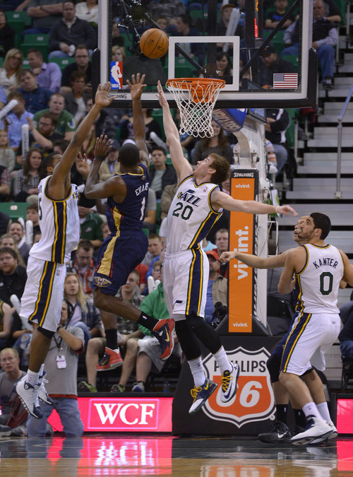 Leah Hogsten  |  The Salt Lake Tribune Utah Jazz center Derrick Favors (15)and Utah Jazz guard Gordon Hayward (20) are teaming up for defensive rebounds. The Utah Jazz are behind the New Orleans Pelicans 45-43 at the half of their game Friday, April 4, 2014 at Energy Solutions Arena.